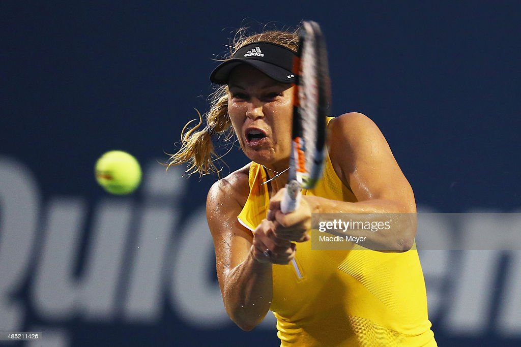 Caroline Wozniaki of Denmark returns a backhand to Alison Riske during their match on day 2 of the Connecticut Open at Connecticut Tennis Center at Yale on August 25, 2015 in New Haven, Connecticut.