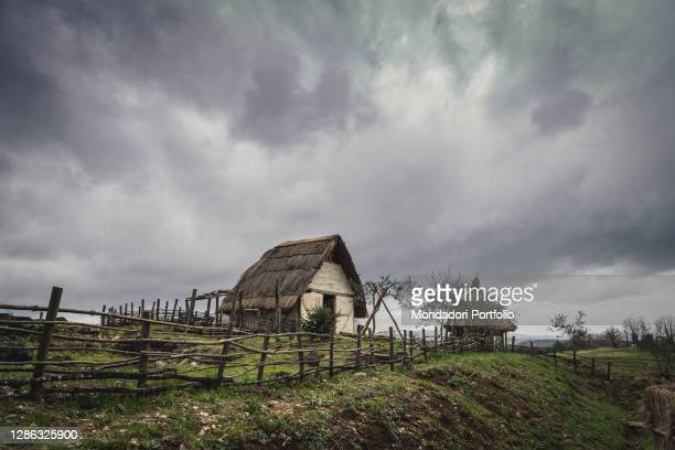Carolingian period. Hypothetical reenactment of customs and traditions in a Frank village . Overall view of the houses of the Archaeological Park....
