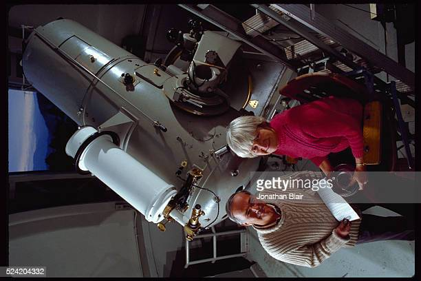 Carolyn and Eugene Shoemaker stand by the 18 Schmidt Telescope at the Palomar Observatory They use it to search for asteroids and comets that may...