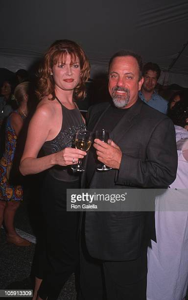 Carolyn Beegan and Billy Joel during Summer Gala Benefit Bash for the Bay Street Theatre July 10 1999 at Bay Street Theater in Sag Harbor New York...