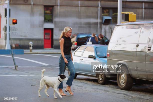 Carolyn Bessette Kennedy arrives home first walking their dog as they return from their honeymoon. Most photogs gathered missed her arrival as they...