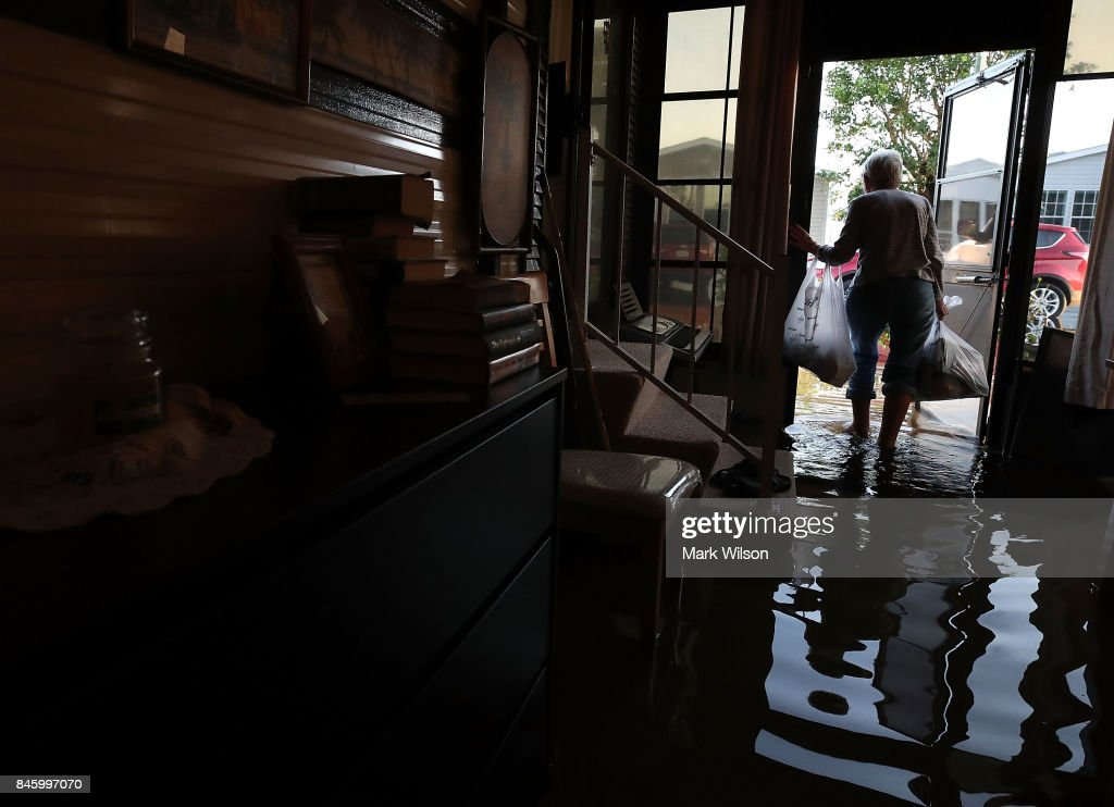 Carolyn Cole removes her belongings from her home that was flooded by Hurricane Irma on September 12, 2017 in Bonita Springs, Florida. On Sunday Hurricane Irma hit Florida's west coast leaving widespread power outages and flooding.