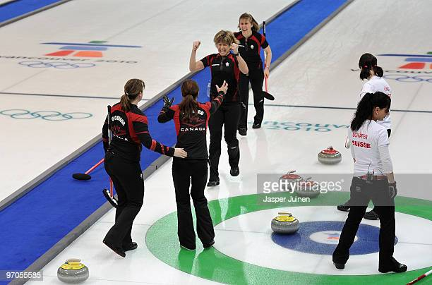 Carolyn Darbyshire of Canada clenches her fists as she celebrates with her teammates Susan O'Connor skip Cheryl Bernard and Cori Bartel as Carmen...