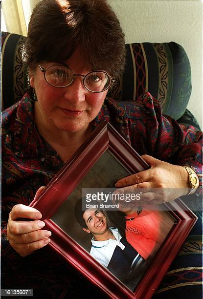 Carolyn Dobson at her home with a photo of her late son John Robert Adamo killed in 1997