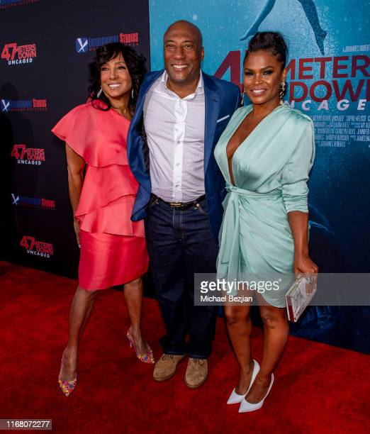 Carolyn Folks Byron Allen and Nia Long attend the LA Premiere of 47 Meters Down UNCAGED on August 13 2019 in Los Angeles California