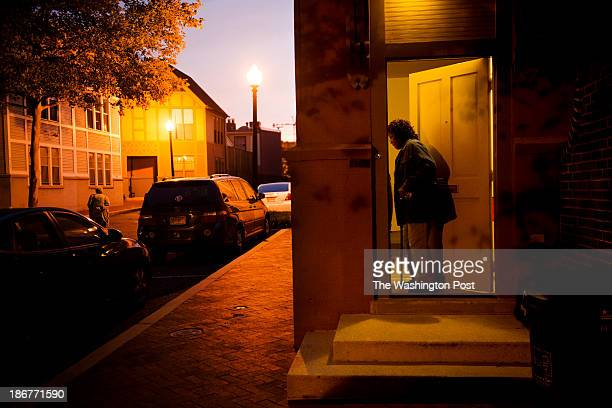 Carolyn Gaskins enters her home as her friend, Dorothy Wolley left, walks through the Townhomes on Capitol Hill development towards her home on Ellen...
