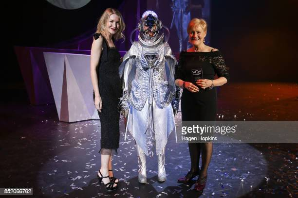 Carolyn Gibson of New Zealand poses with her creation 'The Seeker' and David Jones buying manager Teneille Ferguson after winning the New Zealand...