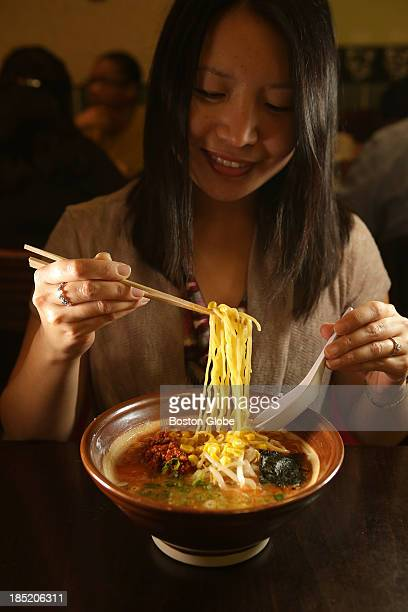 Carolyn Hann visiting from Washington DC with a bowl of Spicy Miso Ramen at Sapporo Ramen inside the Porter Exchange in Cambridge