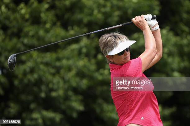 Carolyn Hill plays a tee shot on the first hole during the first round of the US Senior Women's Open at Chicago Golf Club on July 12 2018 in Wheaton...