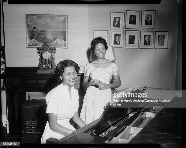 Carolyn J McClellon at piano and vocalist Marva M Josie standing beside her in Hayes School of Music 1955