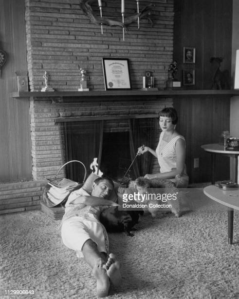 Carolyn Jones and Aaron Spelling at home with their dogs in on January 25, 1957.