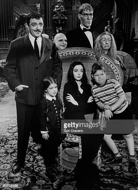 Carolyn Jones and John Astin with other cast members during scene from program The Addams Family