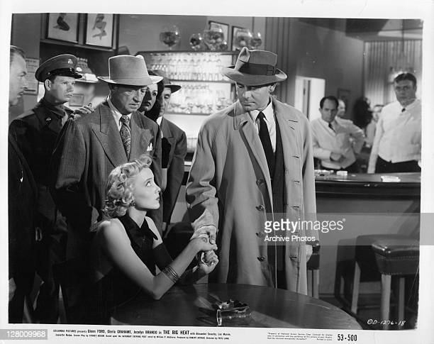 Carolyn Jones holding Glenn Ford's hand in a scene from the film 'The Big Heat' 1953