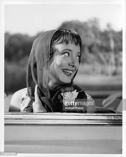Carolyn Jones in convertible in a scene from the film 'The Man In The Net' 1959