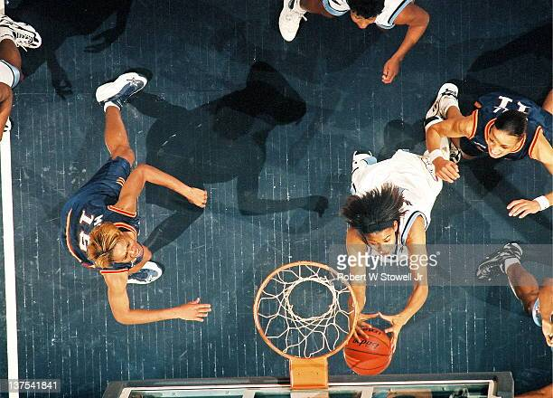 Carolyn Jones of the American Basketball League's New England Blizzard grabs a rebound in a game against the Columbus Quest Hartford CT 1997