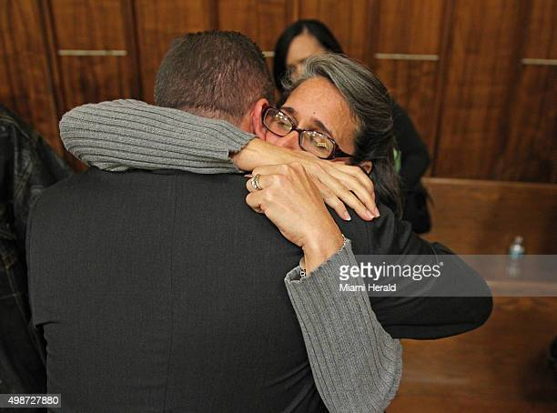 Carolyn Knox mother of murder victim Jennifer Alfonso receives a hug from MiamiDade homocide Det Jonathan Grossman after Miami Facebook killer Derek...