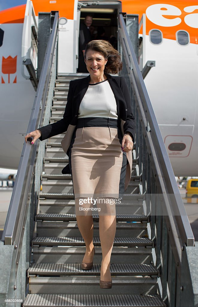 Carolyn McCall, chief executive officer of EasyJet Plc, descends a staircase as she exits an Easyjet passenger aircraft upon arrival at Schiphol Airport, operated by the Schiphol Group, in Amsterdam, Netherlands, on Tuesday, March 31, 2015. The continent's No. 2 discount carrier will base three Airbus A320 jets in the Dutch capital; a push it predicts will add 600,000 passengers, an increase of 16 percent. Photographer: Jasper Juinen/Bloomberg via Getty Images