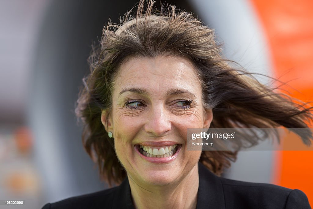 Carolyn McCall, chief executive officer of EasyJet Plc, reacts as she arrives at Schiphol Airport, operated by the Schiphol Group, in Amsterdam, Netherlands, on Tuesday, March 31, 2015. The continent's No. 2 discount carrier will base three Airbus A320 jets in the Dutch capital; a push it predicts will add 600,000 passengers, an increase of 16 percent. Photographer: Jasper Juinen/Bloomberg via Getty Images