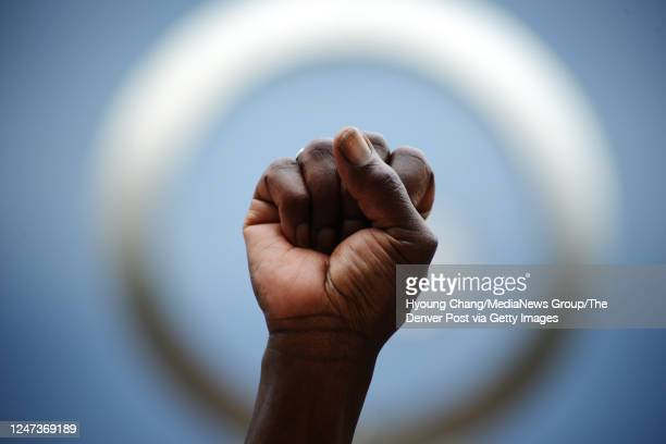 Carolyn Miller gathered with other demonstrators to decry the death and honor the life of Elijah McClain in Aurora Colorado on June 6 2020 McClain...