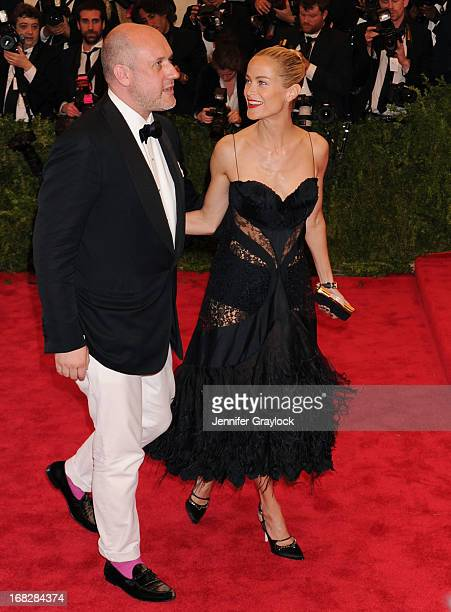 Carolyn Murphy and Peter Copping attends the Costume Institute Gala for the PUNK Chaos to Couture exhibition at the Metropolitan Museum of Art on May...