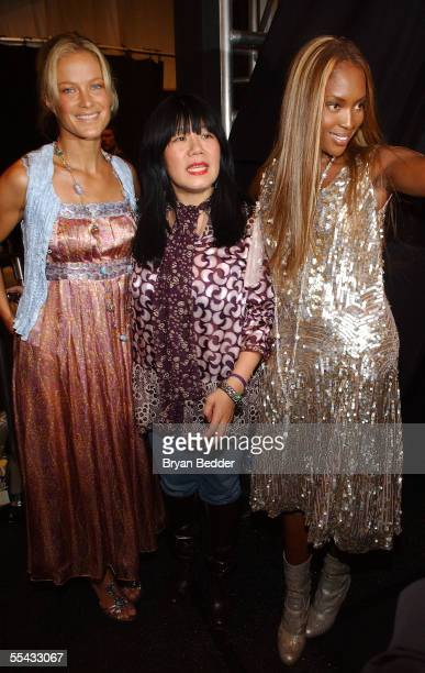 Carolyn Murphy, Anna Sui and Naomi Campbell pose backstage at the Anna Sui Spring 2006 fashion show during Olympus Fashion Week at Bryant Park on...