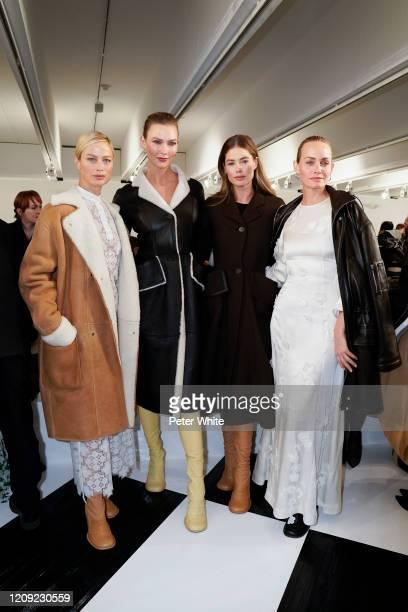 Carolyn Murphy, Karlie Kloss, Doutzen Kroes, and Amber Valletta attend the Loewe show as part of the Paris Fashion Week Womenswear Fall/Winter...