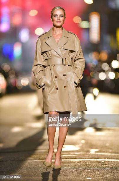 Carolyn Murphy walks along 46th Street during the Michael Kors Fashion Show in Times Square on April 08, 2021 in New York City.