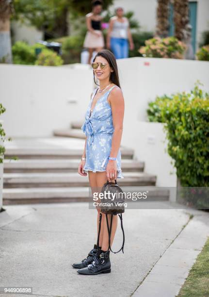 Carolyn Pomeranz wearing blue jumpsuit Louis Vuitton backpack is seen at Revolve Festival on April 15 2018 in Indio California