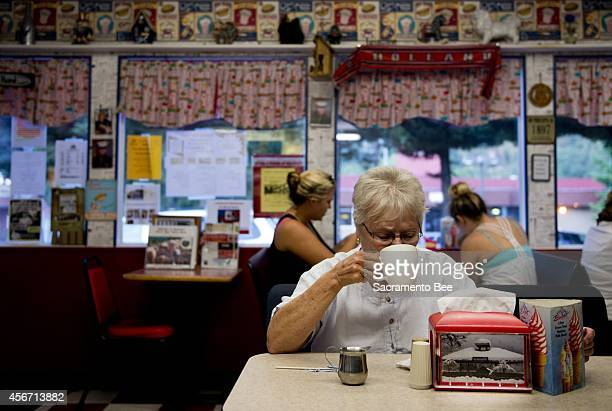 Carolyn Rivard drinks a cup of coffee at the Burger Barn as she makes her way back home from a quilting lesson on Tuesday, Sept. 9 in Dunsmuir,...