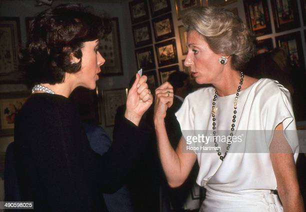 Carolyn Roehm and Marella Agnelli attend a preview at Christie's New York New York 1988