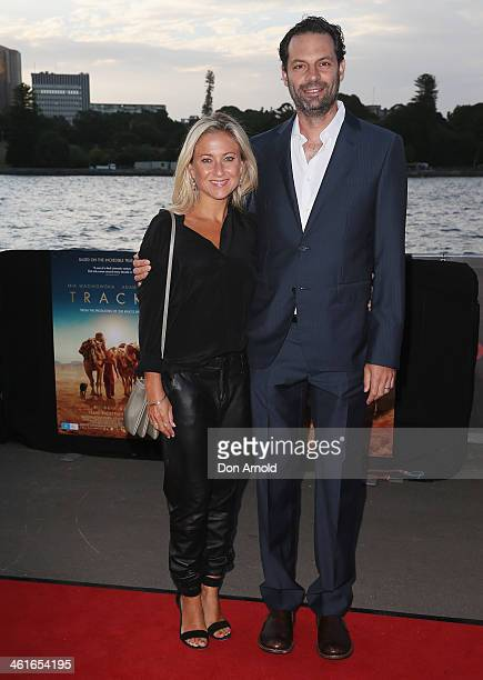 Carolyn Sherman and Emile Sherman pose at the St George Openair Cinema Tracks premiere on January 10 2014 in Sydney Australia
