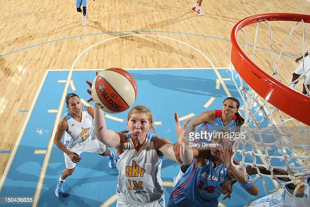 Carolyn Swords of the Chicago Sky grabs a rebound from Erika de Souza of the Atlanta Dream on August 17 2012 at the Allstate Arena in Rosemont...