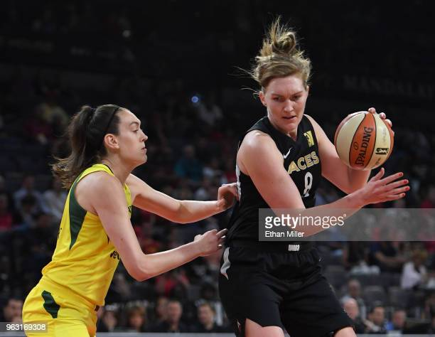 Carolyn Swords of the Las Vegas Aces is guarded by Breanna Stewart of the Seattle Storm during the Aces' inaugural regularseason home opener at the...
