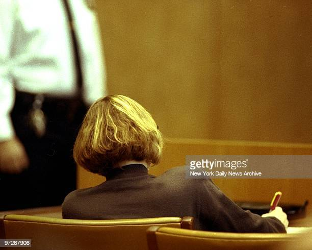 Carolyn Warmus with back to camera at defense table for her fatal attraction trial at White Plains courthouse
