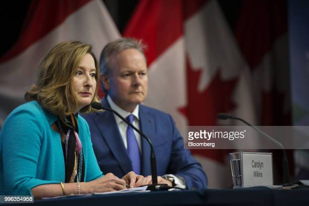 Carolyn Wilkins senior deputy governor at the Bank of Canada left and Stephen Poloz governor of the Bank of Canada listen during a press conference...