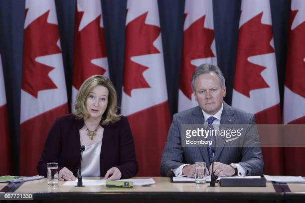 Carolyn Wilkins senior deputy governor at the Bank of Canada left speaks while Stephen Poloz governor of the Bank of Canada listens during a news...