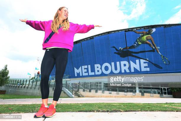 Carolyn Wozniacki of Denmark poses in front of an image of her at Rod Laver Arena ahead of the 2019 Australian Open at Melbourne Park on January 05...