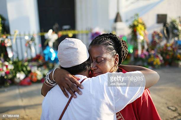 Carolyn WrightPorcher is hugged by her sister Cynthia WrightMurphy as she is overcome with emotion in front of the Emanuel African Methodist...