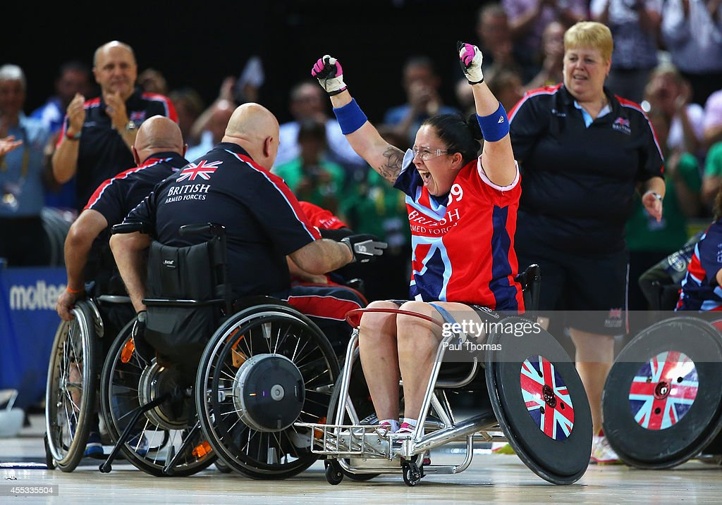 Carolyne Dufley of Great Britain celebrates with team mates after winning the gold medal in the Wheelchair Rugby Gold medal match against the United States during day 2 of the Invictus Games, presented by Jaguar Land Rover at the Copper Box Arena on September 12, 2014 in London, England.