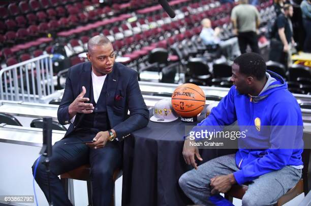Caron Butler moderates a Facebook Live chat with Draymond Green of the Golden State Warriors during practice and media availability as part of the...