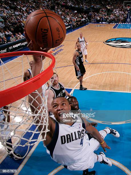 Caron Butler of the Dallas Mavericks goes in for the layup against the San Antonio Spurs during a game at the American Airlines Center on April 14...
