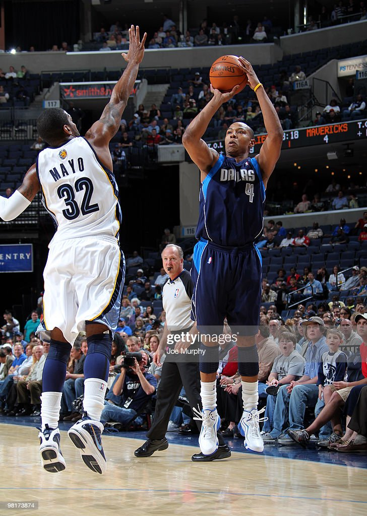 Caron Butler #4 of the Dallas Mavericks shoots over O.J. Mayo #32 of the Memphis Grizzlies on March 31, 2010 at FedExForum in Memphis, Tennessee.