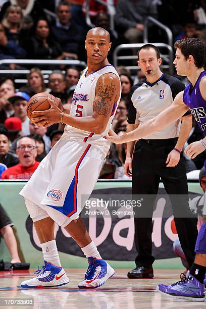 Caron Butler of the Los Angeles Clippers controls the ball against Jimmer Fredette of the Sacramento Kings at Staples Center on December 21 2012 in...