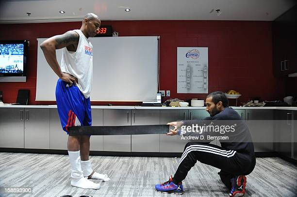 Caron Butler of the Los Angeles Clippers gets ready in the training room before the game against the Sacramento Kings at Staples Center on December...