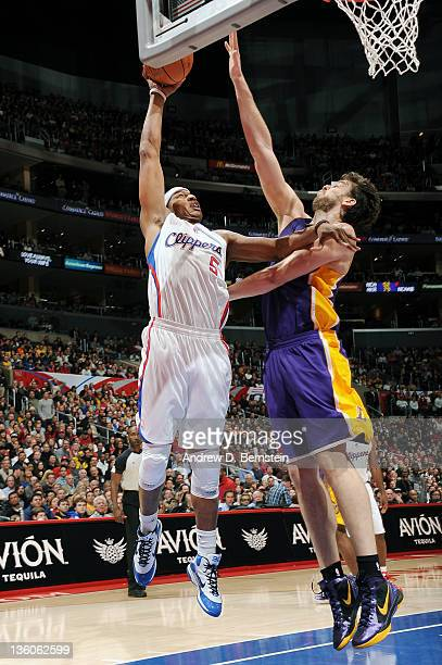 Caron Butler of the Los Angeles Clippers goes to the basket against Pau Gasol of the Los Angeles Lakers at Staples Center on December 21 2011 in Los...