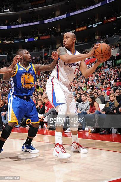 Caron Butler of the Los Angeles Clippers looks for an opening against Nate Robinson of the Golden State Warriors during the game at Staples Center on...
