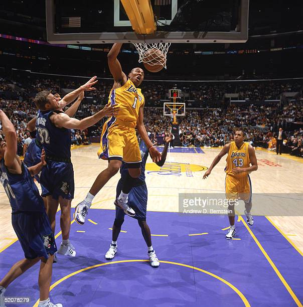 Caron Butler of the Los Angeles Lakers dunks against Fred Hoiberg of the Minnesota Timberwolves during a game at Staples Center on January 19 2005 in...