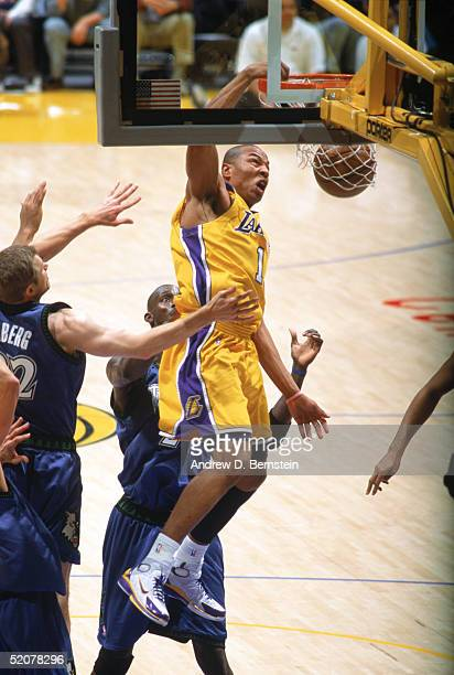 Caron Butler of the Los Angeles Lakers dunks during a game against the Minnesota Timberwolves at Staples Center on January 19 2005 in Los Angeles...