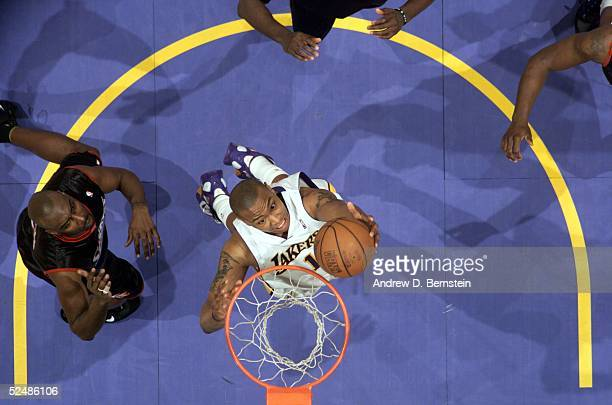 Caron Butler of the Los Angeles Lakers goes to the hoop against John Salmons of the Philadelphia 76ers March 27 2005 at the Staples Center in Los...