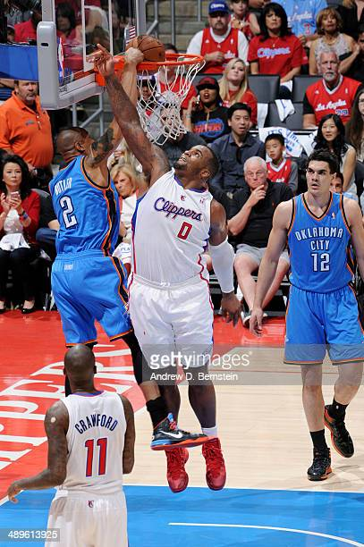 Caron Butler of the Oklahoma City Thunder dunks against Glen Davis of the Los Angeles Clippers in Game Four of the Western Conference Semifinals...
